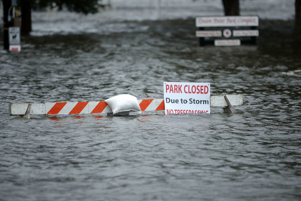 NEW BERN, NC - SEPTEMBER 13:  A sign warns people away from Union Point Park after is was flooded by the Neuse River during Hurricane Florence September 13, 2018 in New Bern, North Carolina. Coastal cities in North Carolina, South Carolina and Virginia are under evacuation orders as the Category 2 hurricane approaches the United States.  (Photo by Chip Somodevilla/Getty Images)