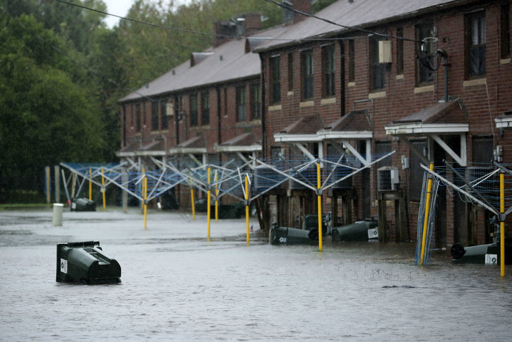 NEW BERN, NC - SEPTEMBER 13:  A transh can floats through the Trent Court public housing apartments after the Neuse River topped its banks during Hurricane Florence September 13, 2018 in New Bern, North Carolina. Coastal cities in North Carolina, South Carolina and Virginia are under evacuation orders as the Category 2 hurricane approaches the United States.  (Photo by Chip Somodevilla/Getty Images)
