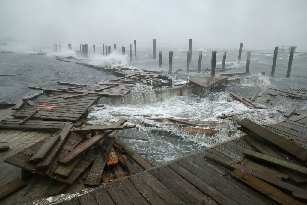 ATLANTIC BEACH, NC - SEPTEMBER 13:  Portions of a boat dock and boardwalk are destroyed by powerful wind and waves as Hurricane Florence arrives September 13, 2018 in Atlantic Beach, United States. Coastal cities in North Carolina, South Carolina and Virginia are under evacuation orders as the Category 2 hurricane approaches the United States.  (Photo by Chip Somodevilla/Getty Images)