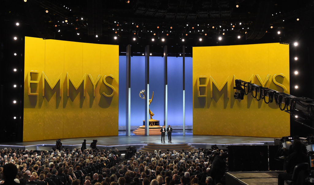 LOS ANGELES, CA - SEPTEMBER 17:  Colin Jost (L) and Michael Che speak onstage during the 70th Emmy Awards at Microsoft Theater on September 17, 2018 in Los Angeles, California.  (Photo by Kevin Winter/Getty Images)