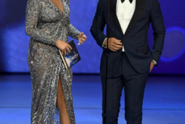 LOS ANGELES, CA - SEPTEMBER 17:  Chrissy Teigen (L) and John Legend speak onstage during the 70th Emmy Awards at Microsoft Theater on September 17, 2018 in Los Angeles, California.  (Photo by Kevin Winter/Getty Images)