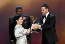 LOS ANGELES, CA - SEPTEMBER 17:  Alex Borstein (C) accepts the Outstanding Supporting Actress in a Comedy Series award for 'The Marvelous Mrs. Maisel' from Tracy Morgan (L) and Jimmy Kimmel (R) onstage during the 70th Emmy Awards at Microsoft Theater on September 17, 2018 in Los Angeles, California.  (Photo by Kevin Winter/Getty Images)