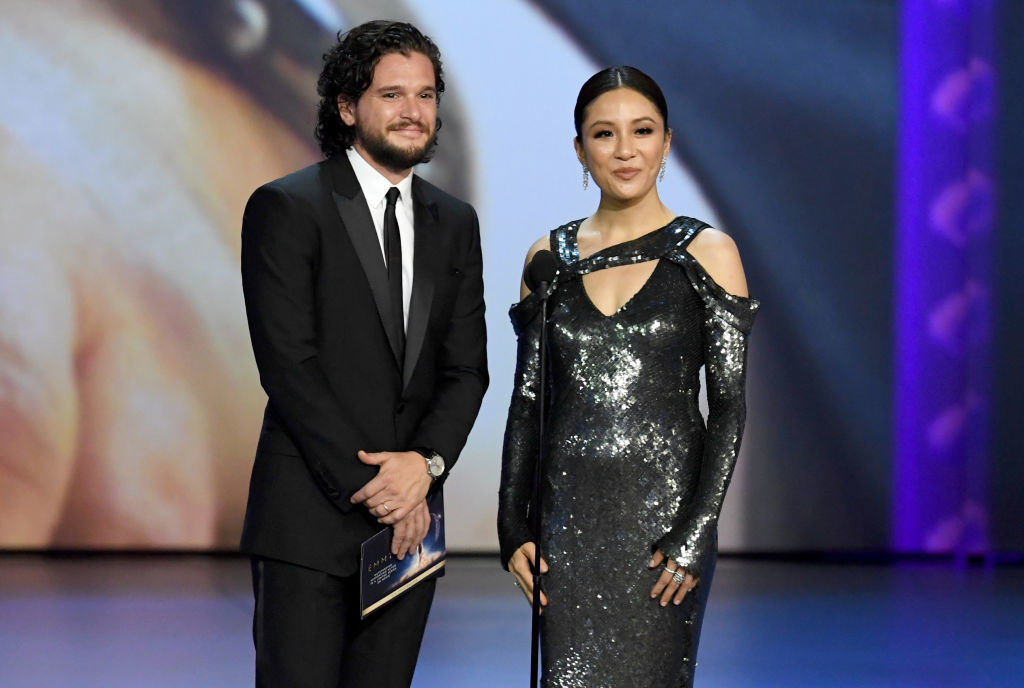 LOS ANGELES, CA - SEPTEMBER 17:  Kit Harington (L) and Constance Wu speak onstage during the 70th Emmy Awards at Microsoft Theater on September 17, 2018 in Los Angeles, California.  (Photo by Kevin Winter/Getty Images)