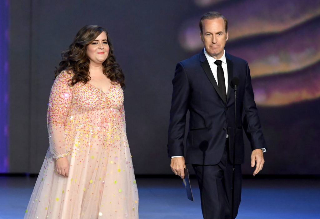 LOS ANGELES, CA - SEPTEMBER 17:  Aidy Bryant (L) and Bob Odenkirk walk onstage during the 70th Emmy Awards at Microsoft Theater on September 17, 2018 in Los Angeles, California.  (Photo by Kevin Winter/Getty Images)
