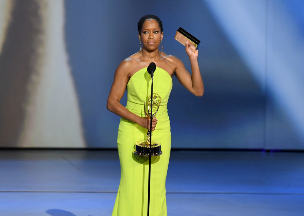 LOS ANGELES, CA - SEPTEMBER 17:  Regina King accepts the Outstanding Lead Actress in a Limited Series or Movie award for 'Seven Seconds' onstage during the 70th Emmy Awards at Microsoft Theater on September 17, 2018 in Los Angeles, California.  (Photo by Kevin Winter/Getty Images)