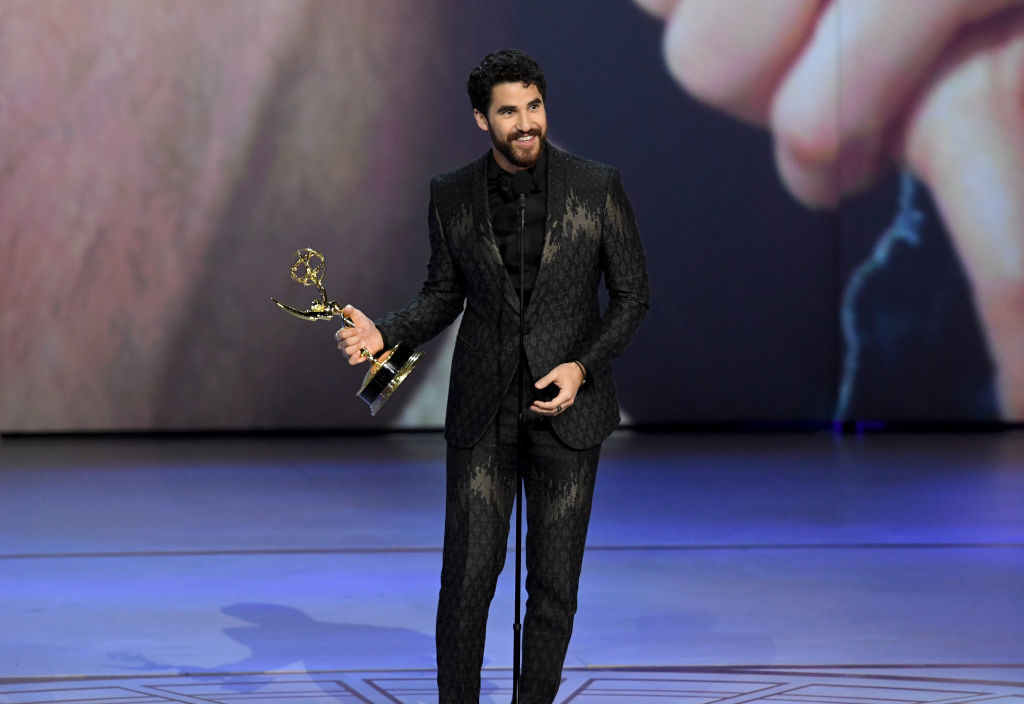 LOS ANGELES, CA - SEPTEMBER 17:  Darren Criss accepts the Outstanding Lead Actor in a Limited Series or Movie award for 'The Assassination of Gianni Versace: American Crime Story' onstage during the 70th Emmy Awards at Microsoft Theater on September 17, 2018 in Los Angeles, California.  (Photo by Kevin Winter/Getty Images)