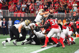 ATLANTA, GA - SEPTEMBER 23: Drew Brees #9 of the New Orleans Saints scores the game-winning touchdown in overtime against the Atlanta Falcons at Mercedes-Benz Stadium on September 23, 2018 in Atlanta, Georgia. (Photo by Scott Cunningham/Getty Images)