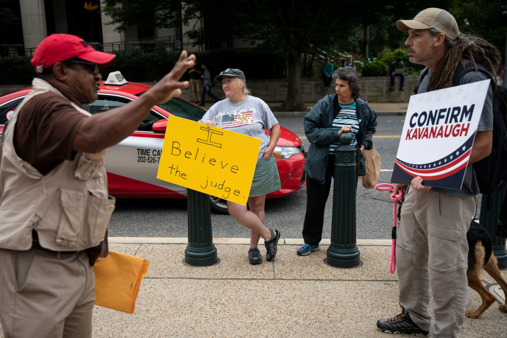 WASHINGTON, DC - SEPTEMBER 27: (L-R) A protestor and a pro-Kavanaugh supporter argue outside the Dirksen Senate Office Building on Capitol Hill, September 27, 2018 in Washington, DC. On Thursday, Christine Blasey Ford, who has accused Kavanaugh of sexual assault, testified before the Senate Judiciary Committee. (Photo by Drew Angerer/Getty Images)