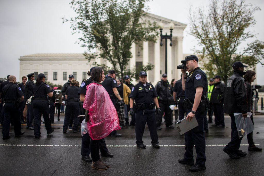WASHINGTON, DC - SEPTEMBER 27: Police arrest protestors demonstrating against Supreme Court Nominee Brett Kavanaugh near the U.S. Supreme Court on September 27, 2018 in Washington, DC. On Thursday, Christine Blasey Ford, who has accused Kavanaugh of sexual assault, is testifying before the Senate Judiciary Committee.  (Photo by Zach Gibson/Getty Images)