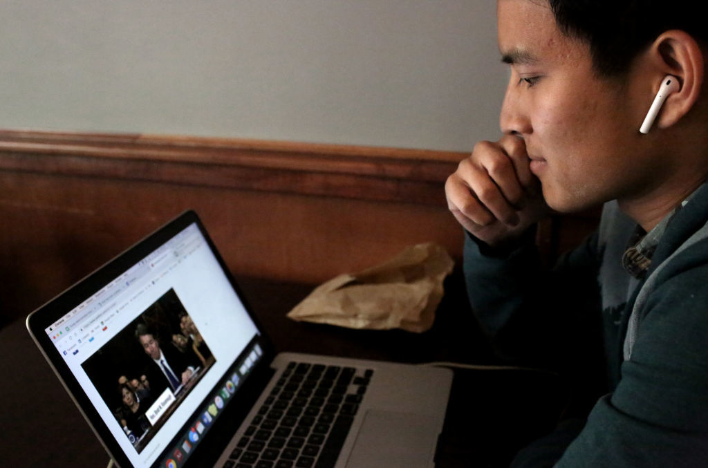 NEW HAVEN, CT - SEPTEMBER 27: A student watches the U.S. Senate Judiciary Committee hearings for testimony from Supreme Court nominee Brett Kavanaugh and Dr. Christine Blasey Ford on his computer at Blue State Coffee, on Yale University's campus on September 27, 2018 in New Haven, Connecticut. Ford, a professor at Palo Alto University and a research psychologist at the Stanford University School of Medicine, has accused Kavanaugh of sexually assaulting her during a party in 1982 when they were high school students in suburban Maryland. (Photo by Yana Paskova/Getty Images)
