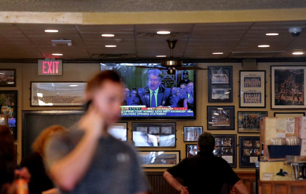 NEW HAVEN, CT - SEPTEMBER 27: A TV inside Yorkside Pizza Restaurant shows the U.S. Senate Judiciary Committee hearings for testimony from Supreme Court nominee Brett Kavanaugh and Dr. Christine Blasey Ford, on Yale University's campus on September 27, 2018 in New Haven, Connecticut. Ford, a professor at Palo Alto University and a research psychologist at the Stanford University School of Medicine, has accused Kavanaugh of sexually assaulting her during a party in 1982 when they were high school students in suburban Maryland. (Photo by Yana Paskova/Getty Images)