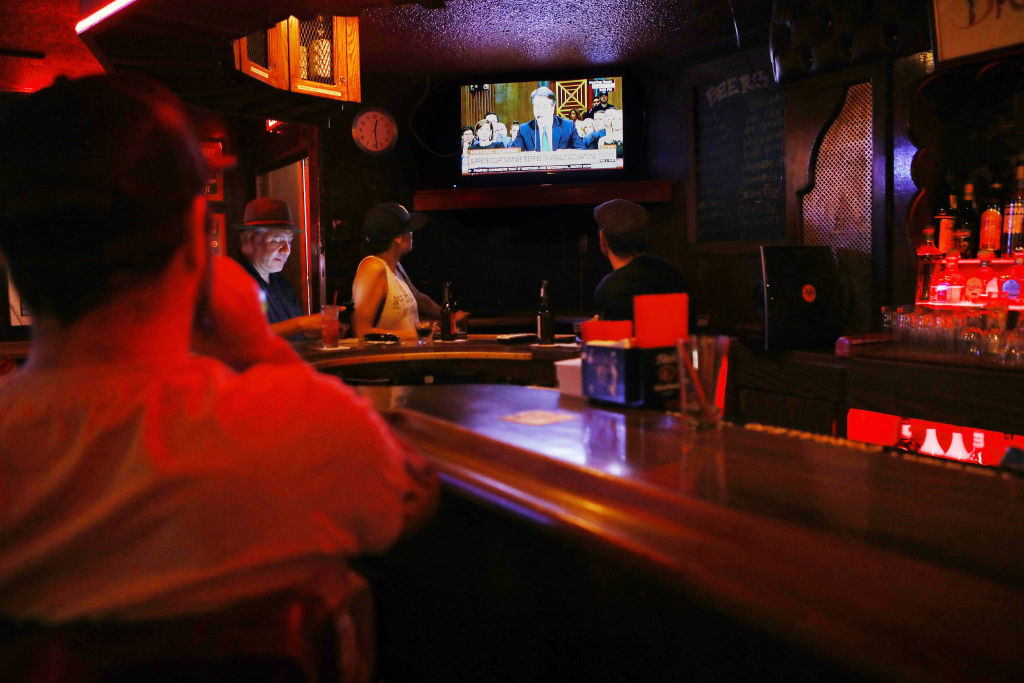 LOS ANGELES, CA - SEPTEMBER 27:  People watch a television broadcast as Brett Kavanaugh testifies during the Senate hearing over Brett Kavanaugh's Supreme Court nomination on September 27, 2018 in Los Angeles, California. A professor at Palo Alto University and a research psychologist at the Stanford University School of Medicine, Dr. Christine Blasey Ford has accused Supreme Court nominee Judge Brett Kavanaugh of sexually assaulting her during a party in 1982 when they were high school students in suburban Maryland.  (Photo by Mario Tama/Getty Images)