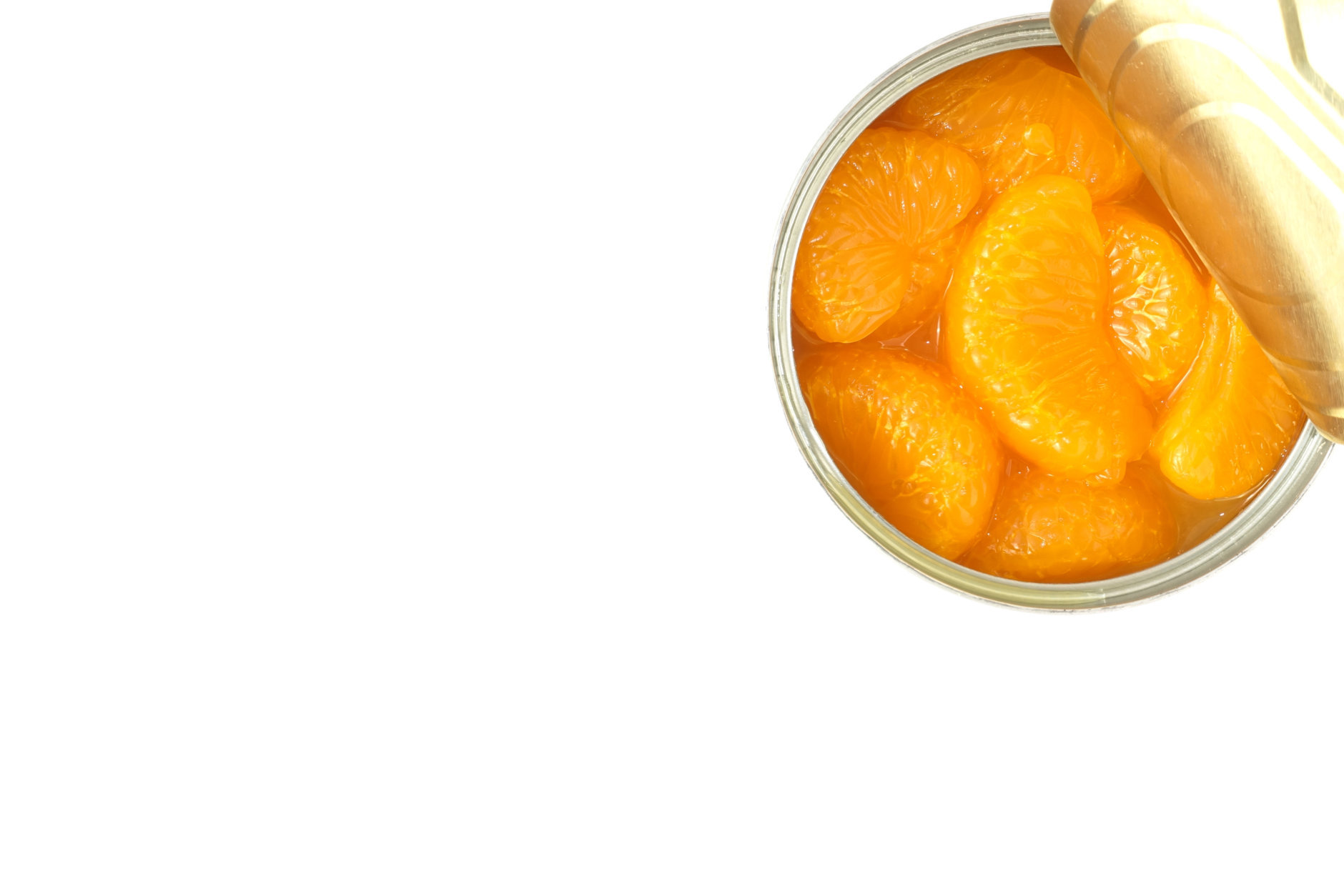 Closeup of an opened can of mandarin oranges on white background with copy space.