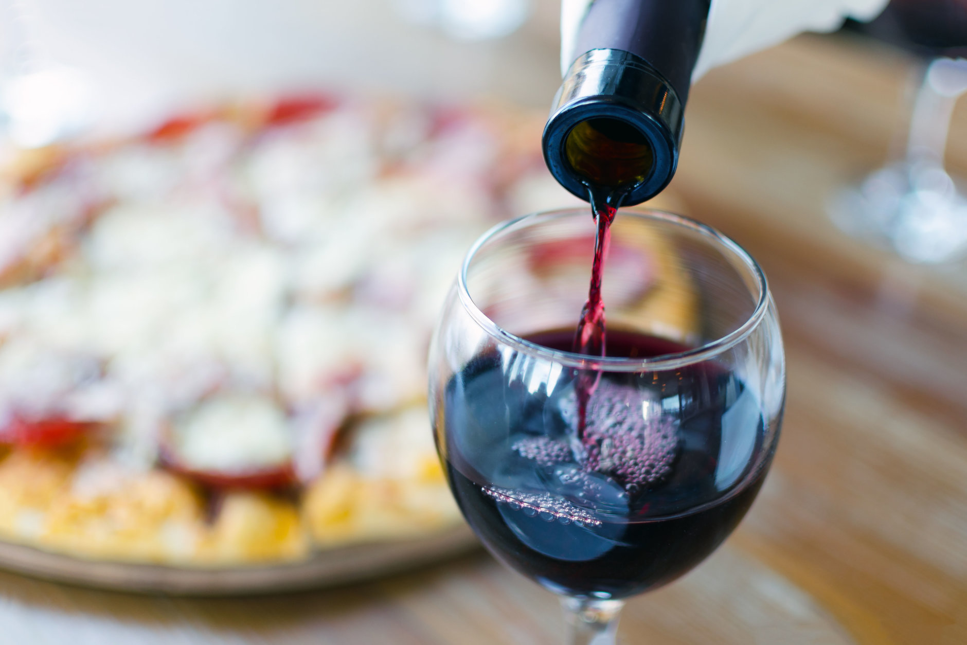 Surrender to the siren call of carryout pizza and a good bottle of wine. (Getty Images)