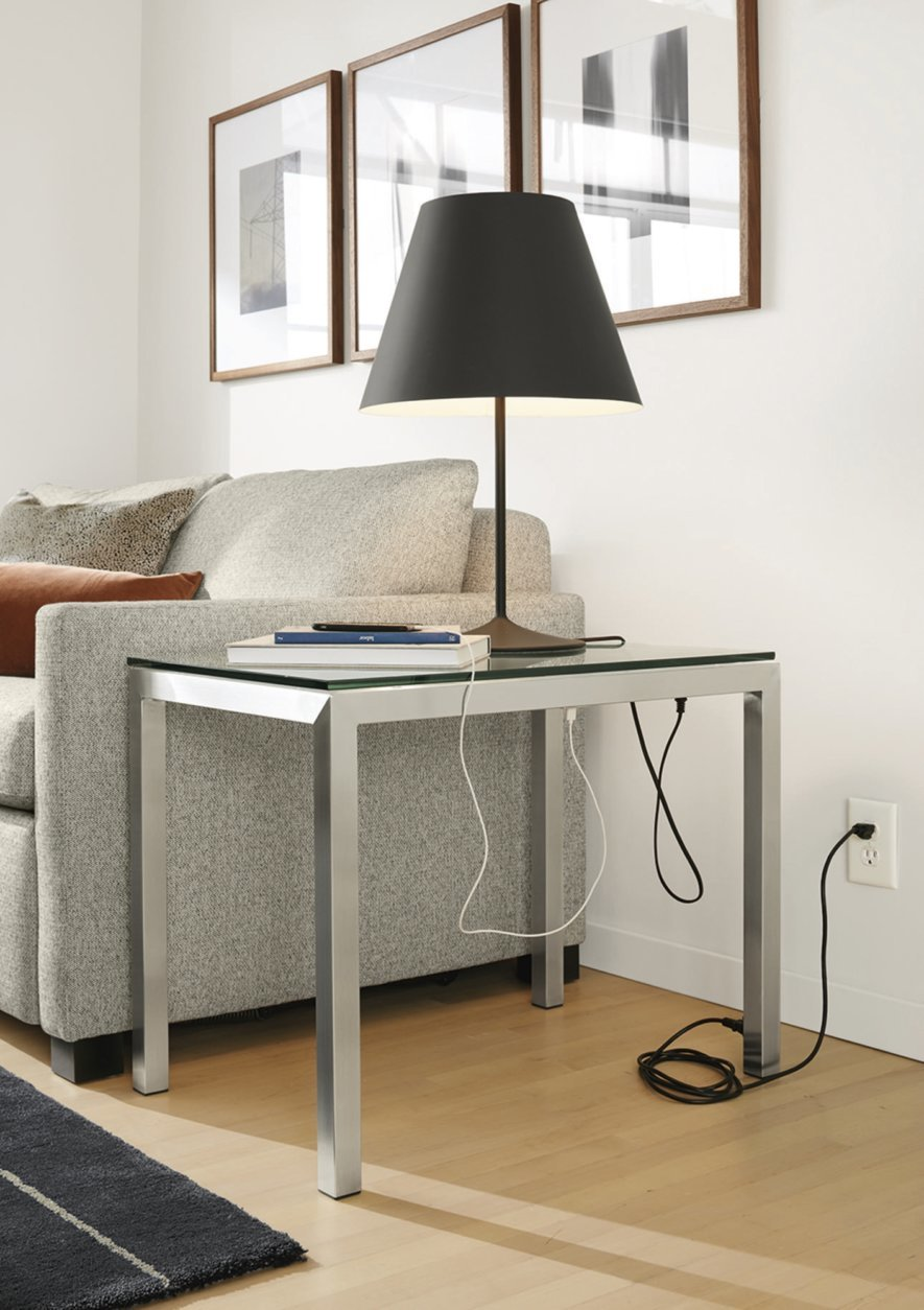This photo provided by Room & Board shows the Portica end table from Room & Board, which comes both standard and in a C-shaped version, which can be useful for tight spaces. Choose your own top: glass, quartz or marble composite, or woods like walnut, maple, spalted sugarberry and ash. (Room & Board via AP)