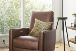This photo provided by Room & Board shows the Ellison chair. Designers have tackled the clunky traditional recliner, coming up with some sleeker, more stylish versions. At Room & Board the Ellison, which comes in a fine-grained leather, is available with USB ports. (Room & Board via AP)