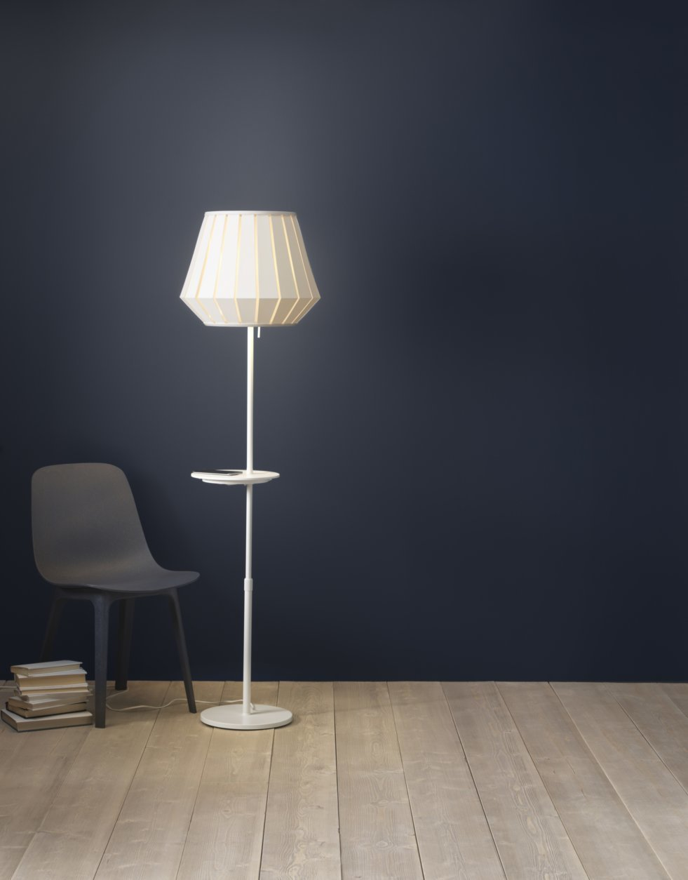 This undated photo provided by Inter IKEA Systems B.V. 2018 shows the VARV floor lamp, which allows you to charge 2 devices at once with a USB port built into the lamp, and a built in charger on the table for wireless charging. (Inter IKEA Systems B.V. 2018 via AP)