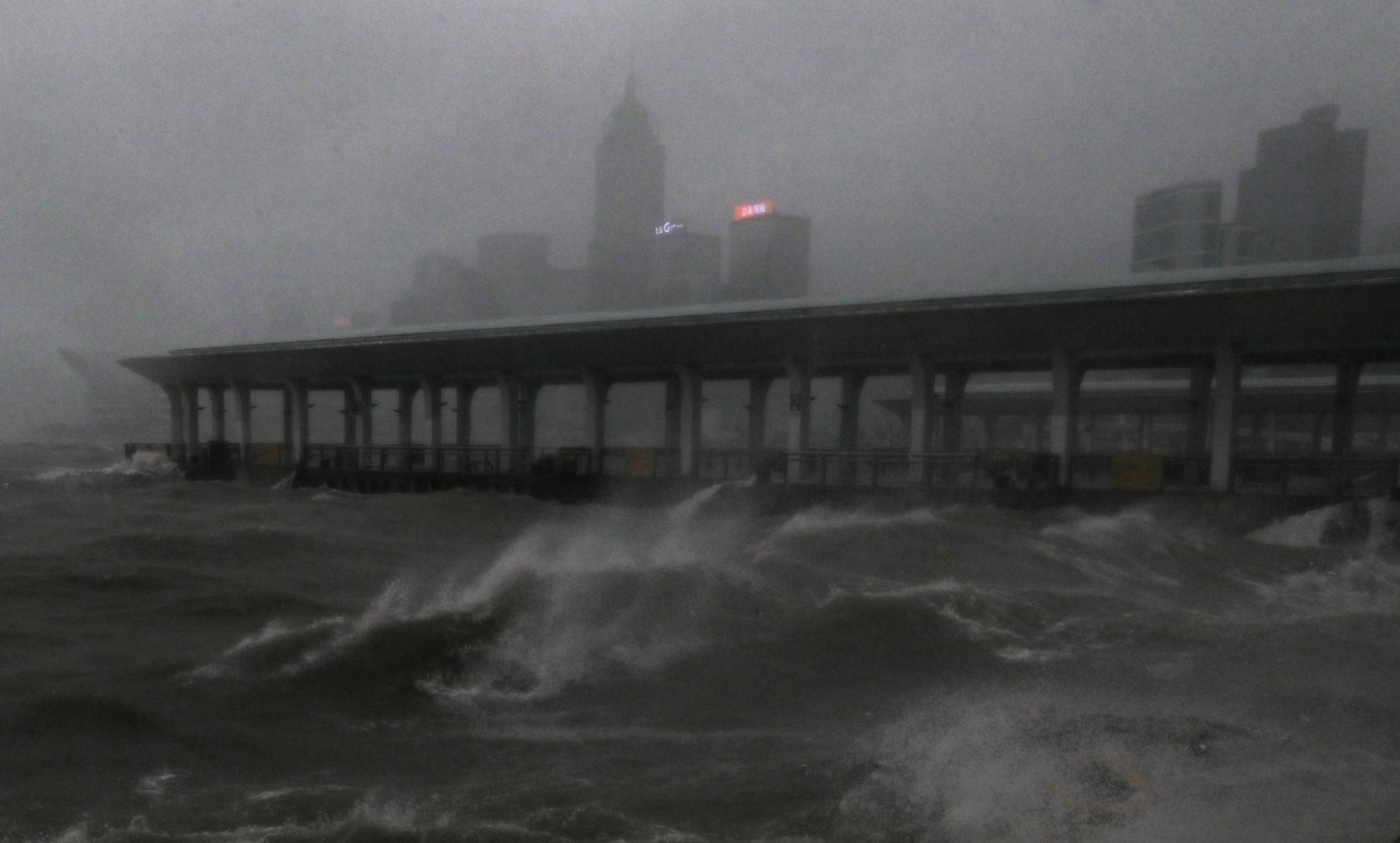Strong wind caused by Typhoon Mangkhut churns waves on the waterfront of Victoria Habour Hong Kong, Sunday, Sept. 16, 2018. Hong Kong and southern China hunkered down as strong winds and heavy rain from Typhoon Mangkhut lash the densely populated coast. The biggest storm of the year left at least 28 dead from landslides and drownings as it sliced through the northern Philippines. (AP Photo/Vincent Yu)