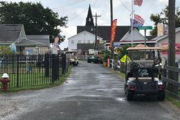 Golf carts and bicycles are the most common form of transportation on Tangier Island's narrow streets. There are few cars. (WTOP/Michelle Basch)