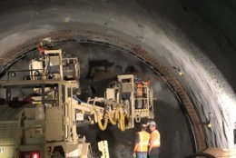 Machinery digs into the Purple Line tunnel. (WTOP/Max Smith)