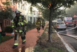 Firefighters work to put out the blaze at 900 5th St. SE in D.C. (WTOP/Dick Uliano)