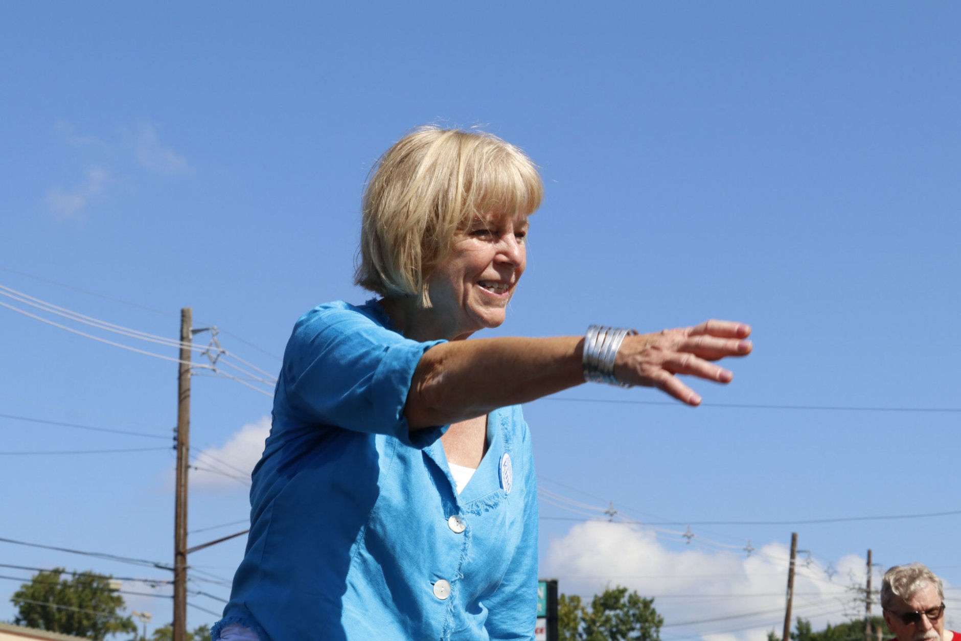 Independent Nancy Floreen, who is running for Montgomery County Executive, greets spectators at the Labor Day Parade. (WTOP/Kate Ryan)