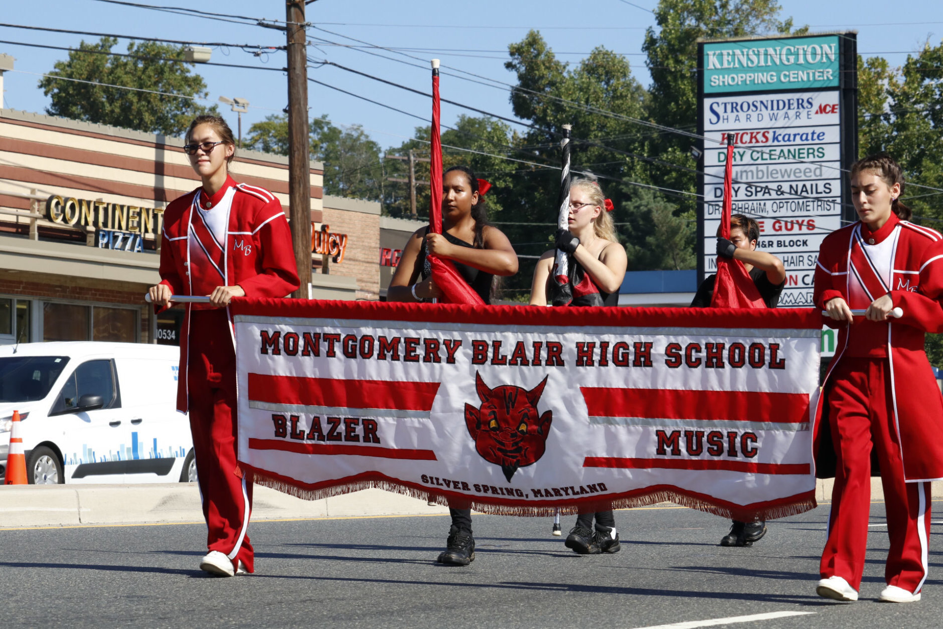The Montgomery Blair High School marching band plays in the Kensington Labor Day Parade. (WTOP/Kate Ryan)