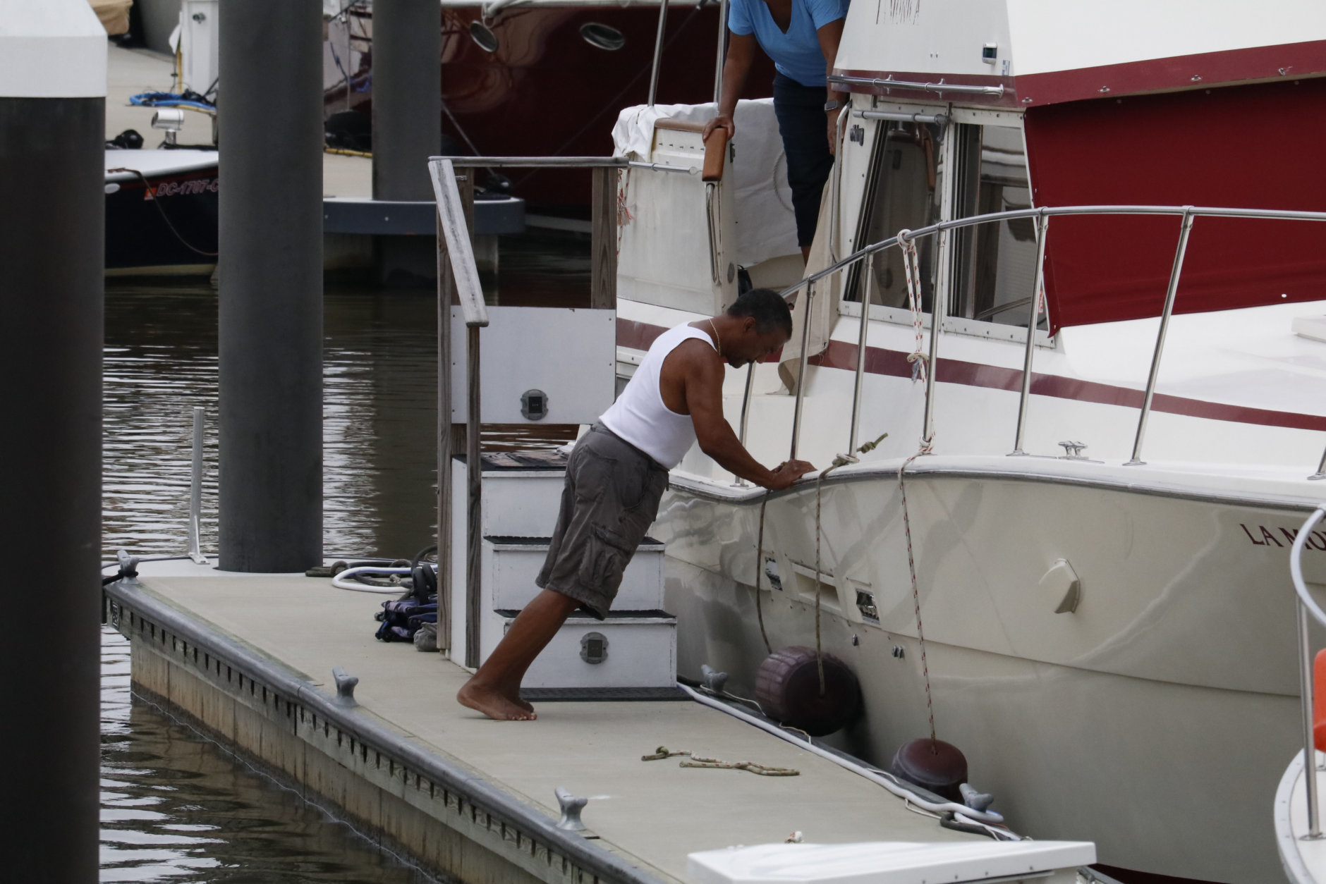Boat owners along DC's Wharf prepare for whatever the weather sends to the D.C. region. (WTOP/Kate Ryan)