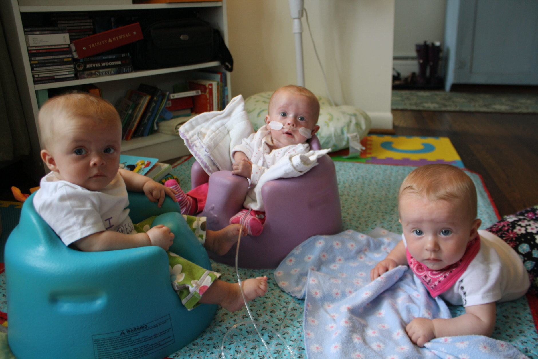 Julia poses with Elise, left, her fraternal twin, and Rose, right, her identical twin. (Courtesy Abigail Rueger)