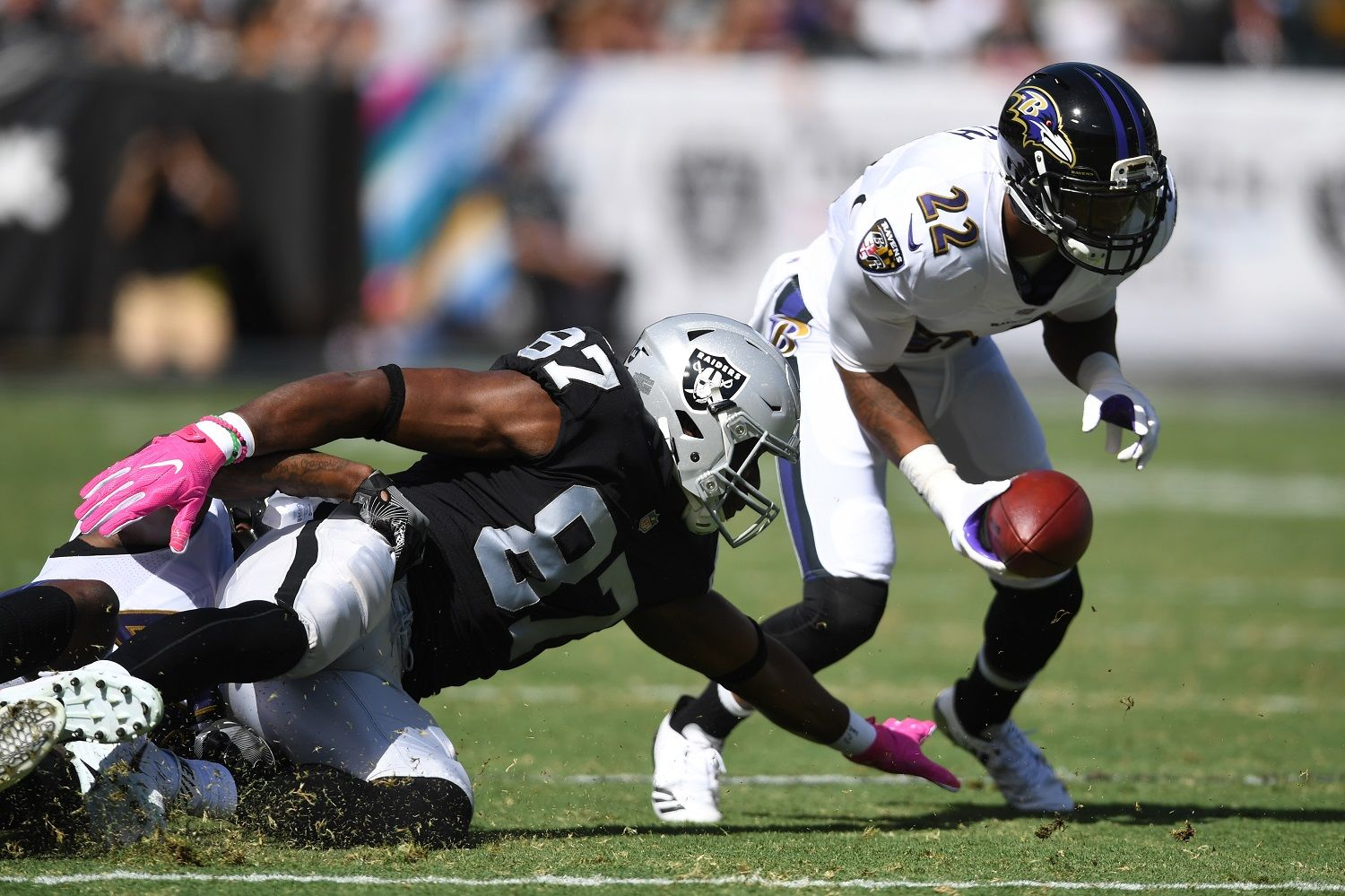 OAKLAND, CA - OCTOBER 08:  Jimmy Smith #22 of the Baltimore Ravens returns a recovered fumble by Jared Cook #87 of the Oakland Raiders for a touchdown during their NFL game at Oakland-Alameda County Coliseum on October 8, 2017 in Oakland, California.  (Photo by Thearon W. Henderson/Getty Images)