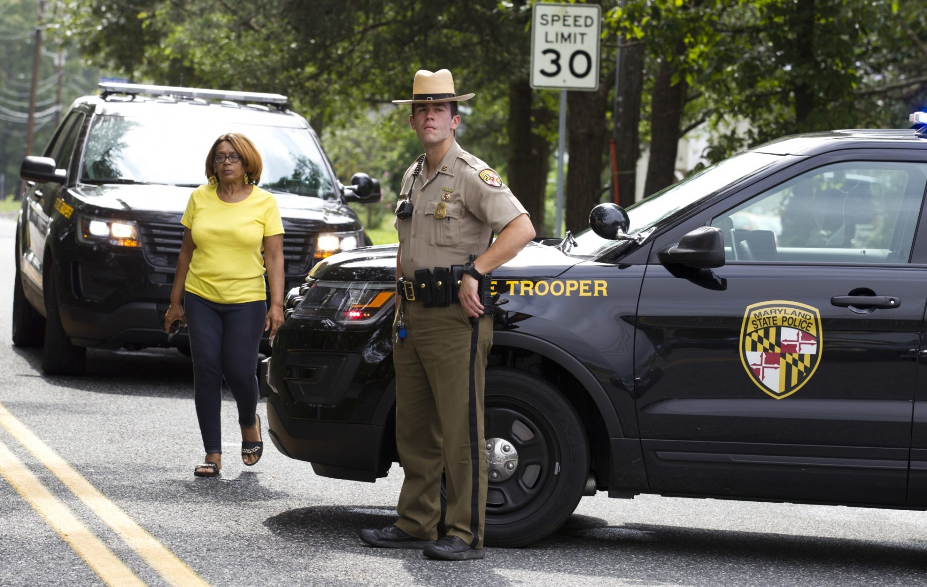 """Maryland state police block the road that connects the industrial business park, where several people had been shot, in Harford County, Md, Thursday, Sept. 20, 2018. Authorities say multiple people have been shot in northeast Maryland in what the FBI is describing as an """"active shooter situation."""" (AP Photo/Jose Luis Magana)"""