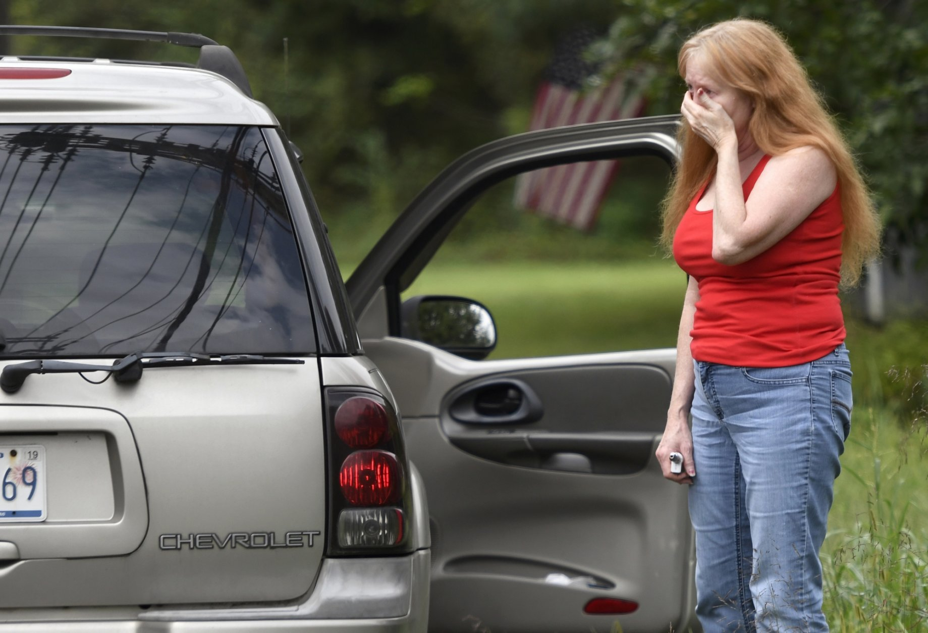 """Shirley Pollack, of Perryville, Md. reacts to what authorities have called a shooting with multiple victims in Perryman, Md. on Thursday, Sept. 20, 2018. Authorities say multiple people have been shot in northeast Maryland in what the FBI is describing as an """"active shooter situation.""""   Pollack,was concerned about her son  who worked near the scene of the shooting.  (AP Photo/Steve Ruark)"""