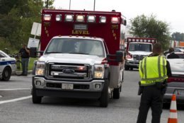 """Ambulance leave the industrial park where several people had been shot, according with police reports in Aberdeen, Md, in Thursday, Sept. 20, 2018. Authorities say multiple people have been shot in northeast Maryland in what the FBI is describing as an """"active shooter situation."""" (AP Photo/Jose Luis Magana)"""