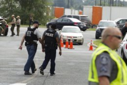 """ATF police officers patrol the industrial business park, where several people had been shot, according with police reports in Aberdeen, Md, in Thursday, Sept. 20, 2018. Authorities say multiple people have been shot in northeast Maryland in what the FBI is describing as an """"active shooter situation."""" (AP Photo/Jose Luis Magana)"""