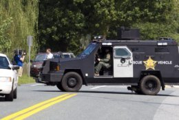 """A Harford County Sheriff's vehicle blocks an entrance at the industrial business park, where several people had been shot, according with police reports in Aberdeen, Md, in Thursday, Sept. 20, 2018. Authorities say multiple people have been shot in northeast Maryland in what the FBI is describing as an """"active shooter situation."""" (AP Photo/Jose Luis Magana)"""