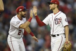 Washington Nationals' Trea Turner, right, celebrates with Adam Eaton (2) after a baseball game against the New York Mets, Saturday, Sept. 22, 2018, in Washington. The Nationals won 6-0.(AP Photo/Nick Wass)