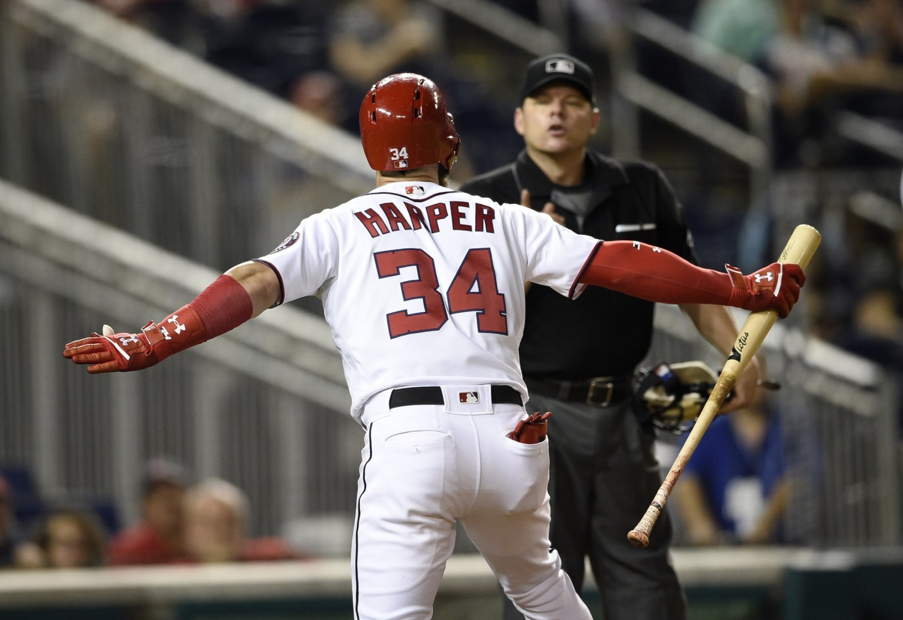 Washington Nationals' Bryce Harper reacts after he was ejected by home plate umpire D.J. Reyburn during the 12th inning of a baseball game against the New York Mets, Thursday, Sept. 20, 2018, in Washington. Harper had been called out on strikes. The Mets won 5-4 in 12 innings. (AP Photo/Nick Wass)