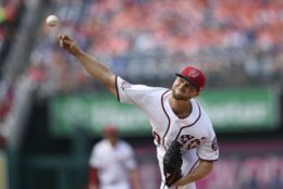 Washington Nationals starting pitcher Austin Voth delivers during the first inning of a baseball game against the New York Mets, Saturday, Sept. 22, 2018, in Washington. (AP Photo/Nick Wass)