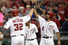 Washington Nationals' Matt Wieters (32) celebrates his three-run home run with Anthony Rendon (6) during the sixth inning of a baseball game against the New York Mets, Saturday, Sept. 22, 2018, in Washington. (AP Photo/Nick Wass)