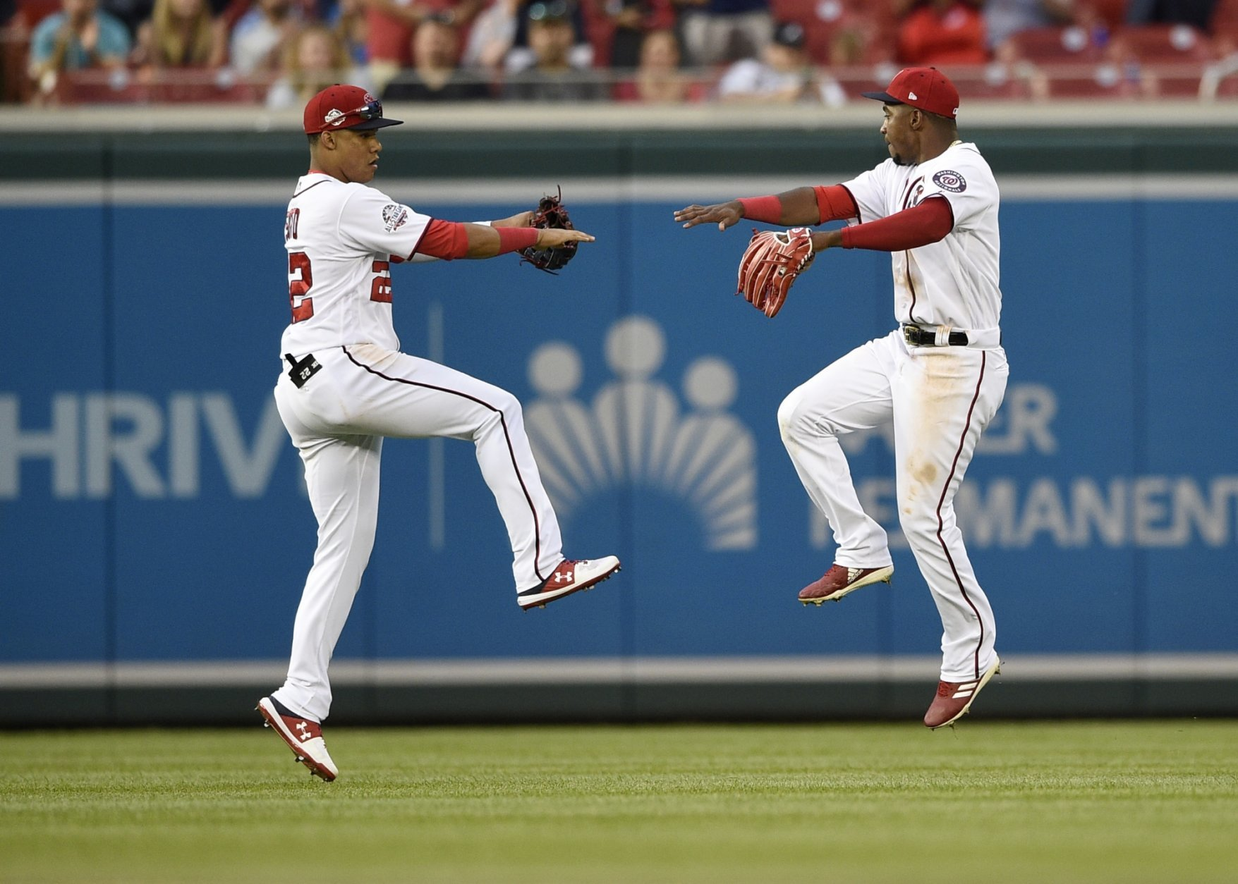 Washington Nationals' Juan Soto celebrates with Victor Robles, right, after a baseball game against the New York Mets, Saturday, Sept. 22, 2018, in Washington. The Nationals won 6-0.(AP Photo/Nick Wass)