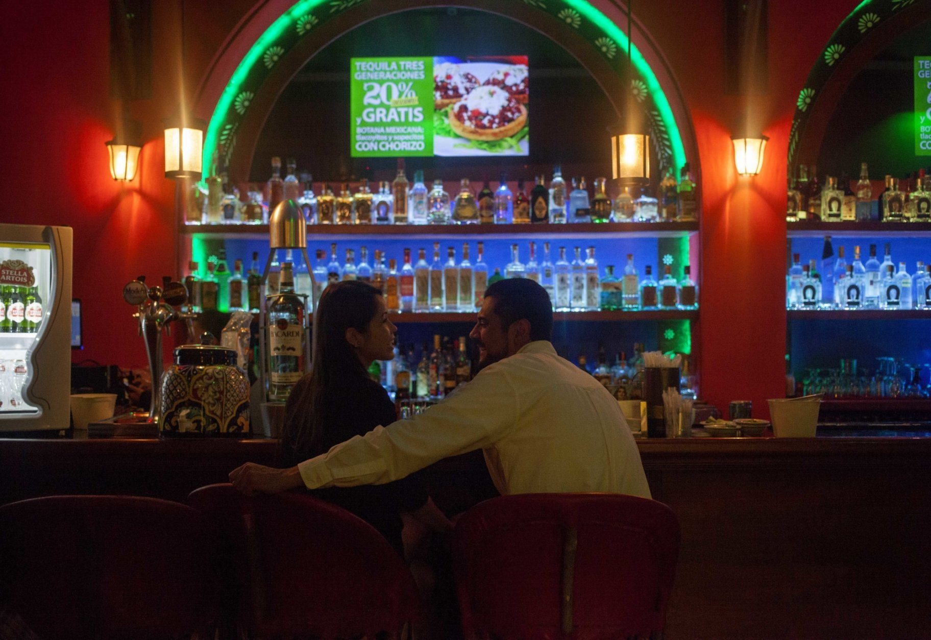 FILE - In this Aug. 21, 2015 file photo, a couple sits in the upstairs bar at the Tenampa cantina at the  Garibaldi Plaza, in Mexico City. At the Tenampa cantina, which bills itself as having first brought mariachi troupes to the plaza in the 1920s, a manager said it was business as usual Saturday, Sept. 15, 2018, despite a brazen Friday night shooting that killed four people and wounded nine in Garibaldi Plaza. (AP Photo/Sofia Jaramillo, File)