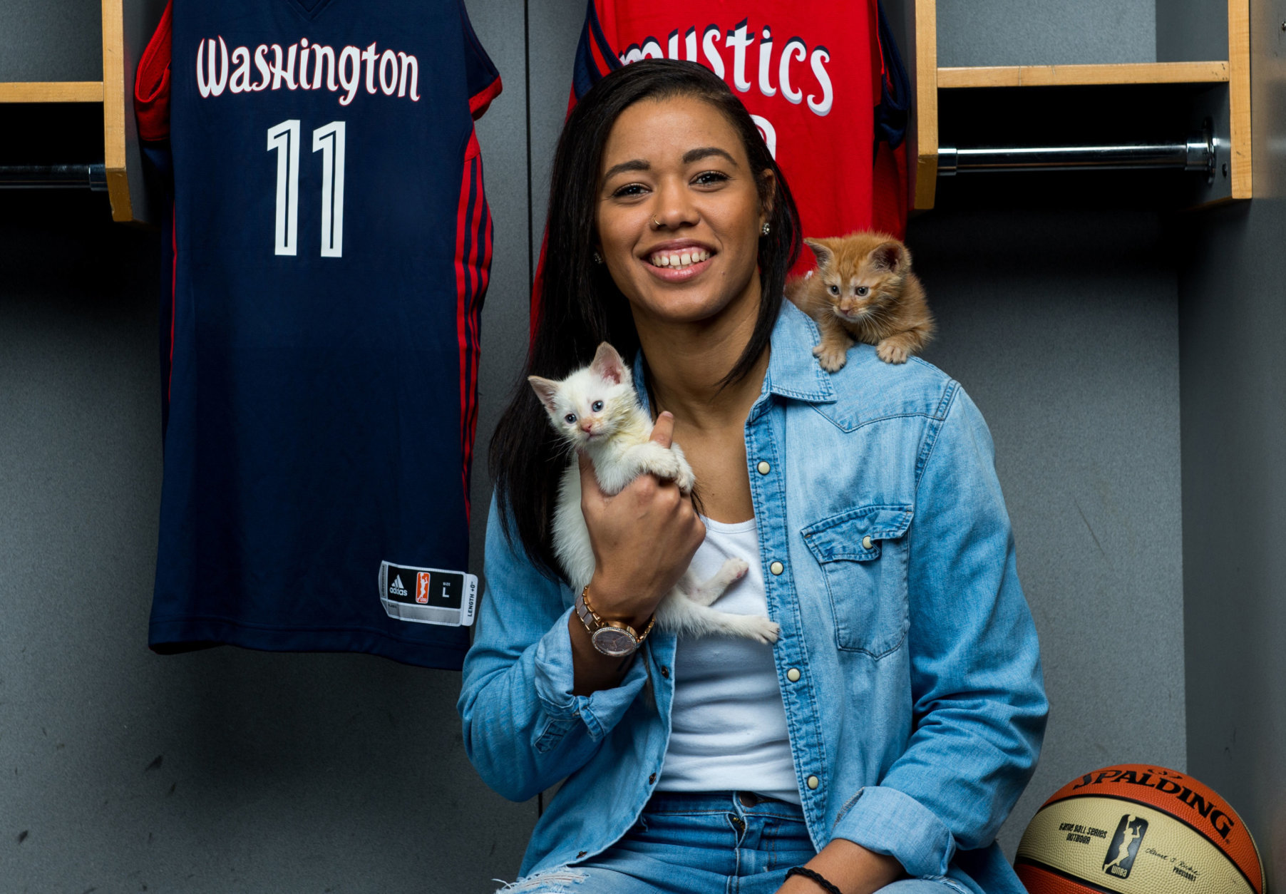The Mystics' Natasha Cloud with two tiny kittens. (Courtesy Humane Rescue Alliance)
