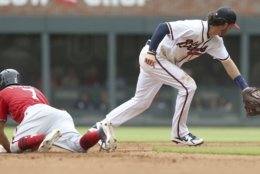 Washington Nationals' Trea Turner (7) dives back to second base on a pop fly as Atlanta Braves Dansby Swanson chases down the ball in the fourth inning of a baseball game Sunday, Sept. 16, 2018, in Atlanta. (AP Photo/Tami Chappell)