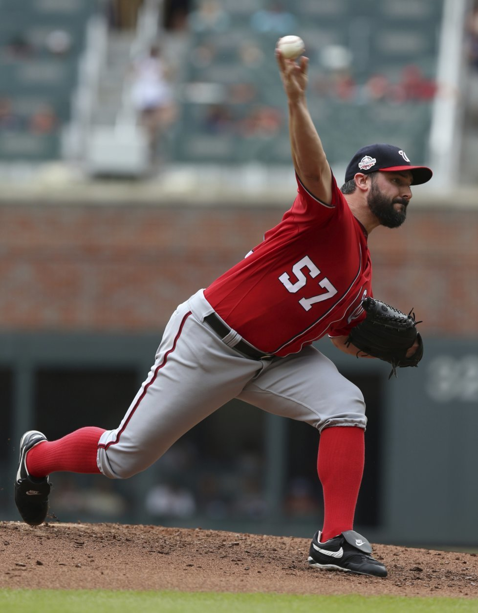 Washington Nationals starting pitcher Tanner Roark throws against the Atlanta Braves during the second inning of a baseball game Sunday, Sept. 16, 2018, in Atlanta. (AP Photo/Tami Chappell)