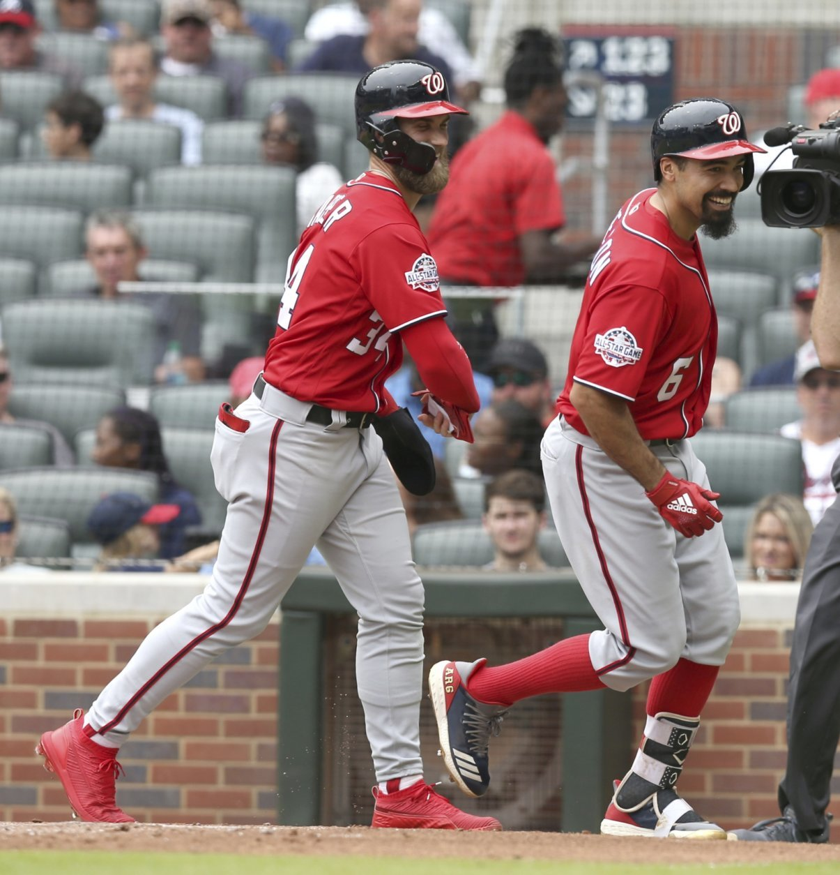 Washington Nationals Bryce Harper celebrates with Anthony Rendon (6) after Rendon's two-run home run against the Atlanta Braves during the third inning of a baseball game Sunday, Sept. 16, 2018, in Atlanta. (AP Photo/Tami Chappell)