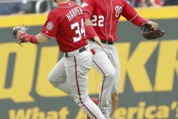 Washington Nationals Bryce Harper (34) celebrates with teammate Juan Soto (22) after they defeated the Atlanta Braves in a baseball game Sunday, Sept. 16, 2018, in Atlanta. (AP Photo/Tami Chappell)