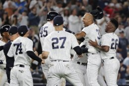 New York Yankees' Aaron Hicks (31) celebrates with teammates after hitting an RBI double during the eleventh inning of a baseball game against the Baltimore Orioles Saturday, Sept. 22, 2018, in New York. The Yankees won 3-2. (AP Photo/Frank Franklin II)