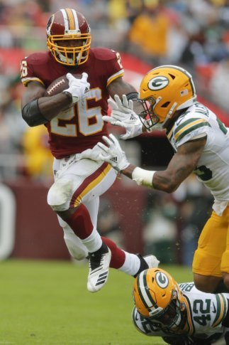 46e48f73c Packers Redskins Football 29661 Washington Redskins running back Adrian  Peterson (26) carries the ball past Green Bay Packers cornerback Jaire  Alexander ...