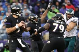 BALTIMORE, MD - DECEMBER 18: Quarterback Joe Flacco #5 of the Baltimore Ravens drops back to pass while teammate offensive tackle Ronnie Stanley #79 blocks against  cornerback Dwayne Gratz #36 of the Philadelphia Eagles in the second quarter at M&T Bank Stadium on December 18, 2016 in Baltimore, Maryland. (Photo by Rob Carr/Getty Images)
