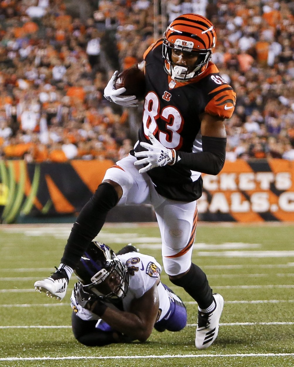 Cincinnati Bengals wide receiver Tyler Boyd (83) breaks away from Baltimore Ravens linebacker Patrick Onwuasor (48) to score a touchdown in the first half of an NFL football game, Thursday, Sept. 13, 2018, in Cincinnati. (AP Photo/Frank Victores)